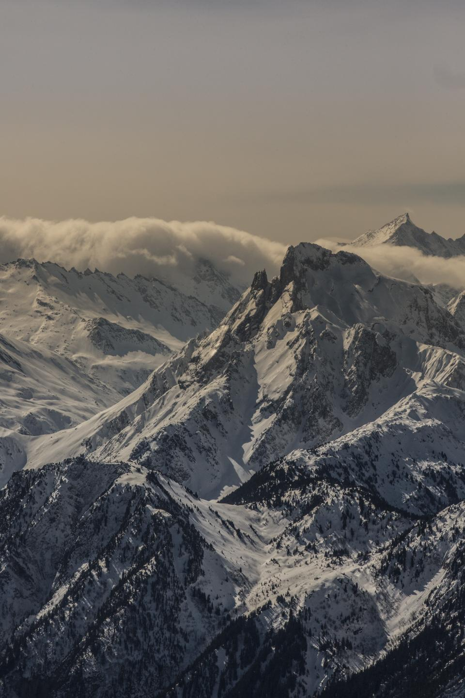 nature landscape mountains summit peaks snow sky horizon clouds blanket rolling texture majestic white