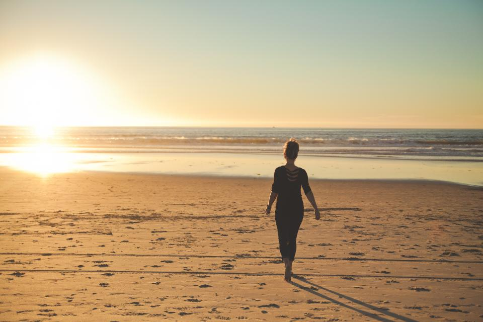 sunset beach ocean sea people woman walking alone silhouette water