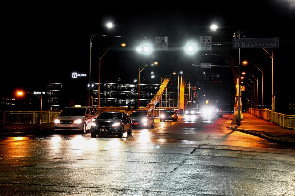road lights headlights cars vehicles traffic bridge night driving