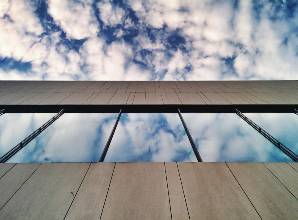 building window sky clouds reflection architecture