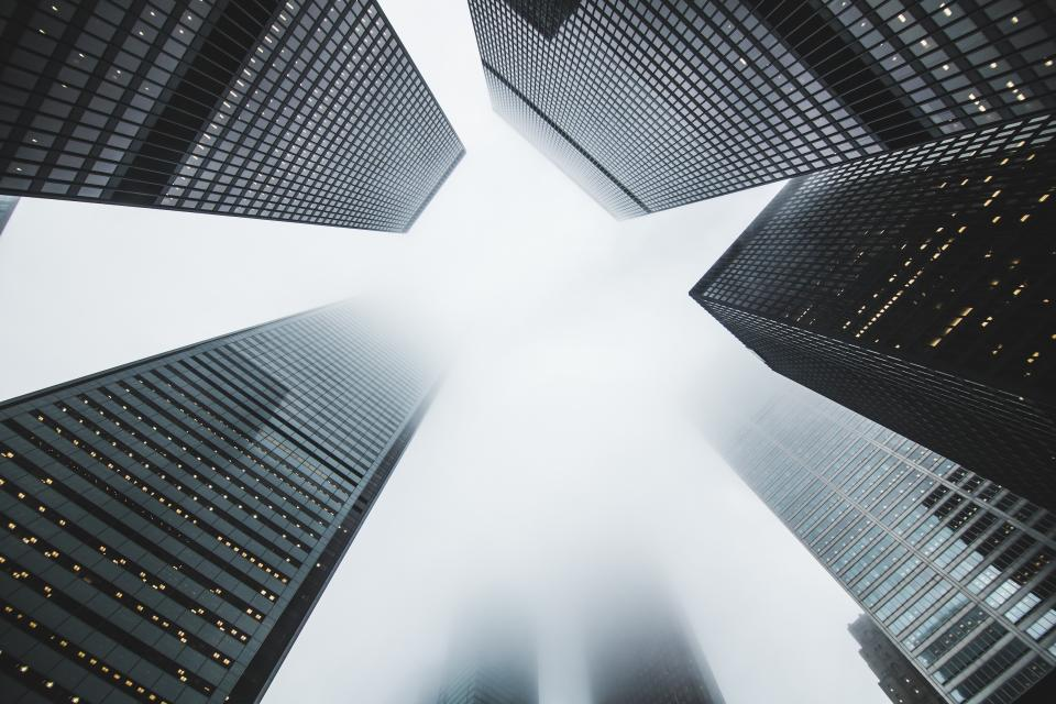 buildings architecture office business corporate windows sky fog foggy clouds city urban