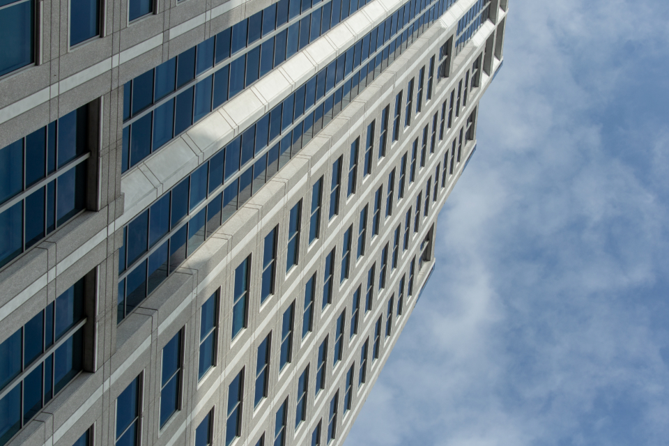 city building sky windows architecture structure office commercial clouds apartments tall high modern exterior business