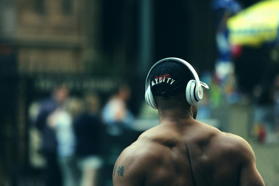 bodybuilder muscles fitness weight lifting training exercise man guy beats headphones city people lifestyle health athlete