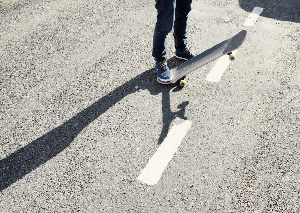 skateboard skater pavement concrete shoes jeans