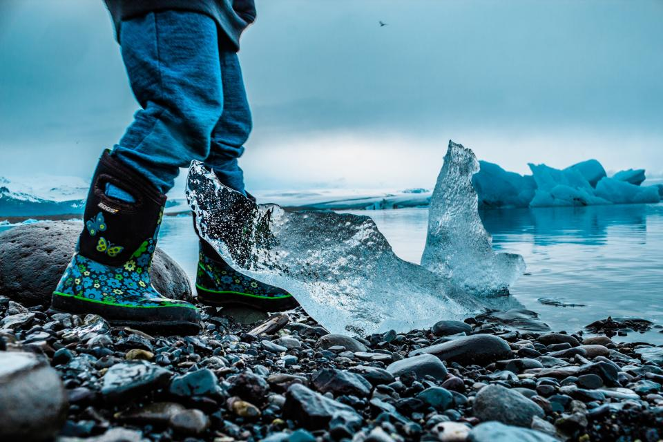 sea ocean water waves nature rocks stone ice iceberg people travel boots snow winter