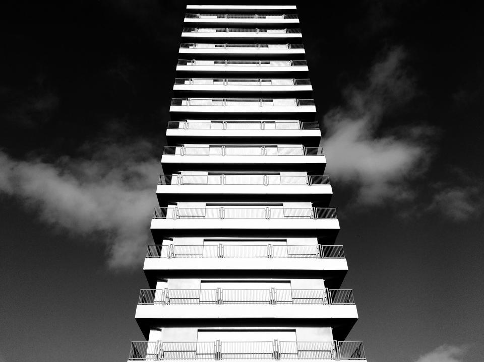 architecture buildings office residential city high rise balconies urban metro nature sky clouds black and white