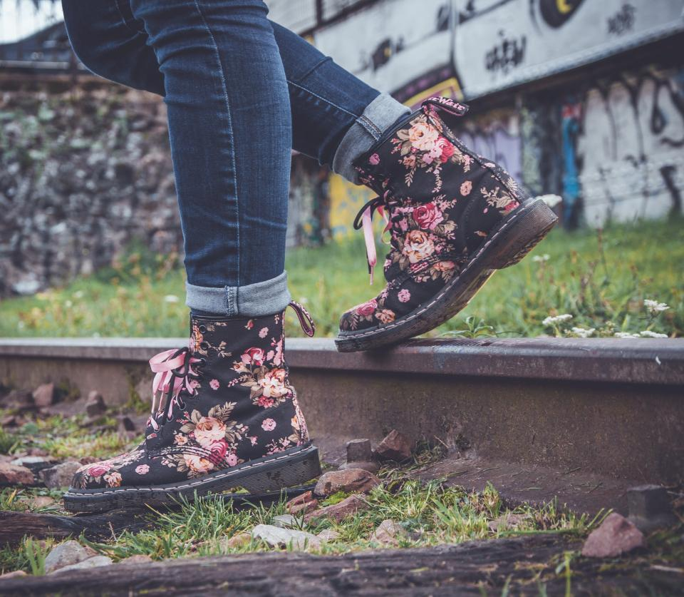 people woman fashion boots flowers denim green grass