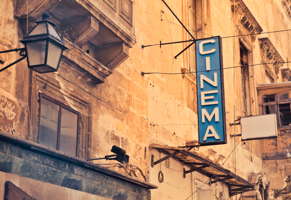 cinema sign typography retro vintage building architecture advertising banner city film movie