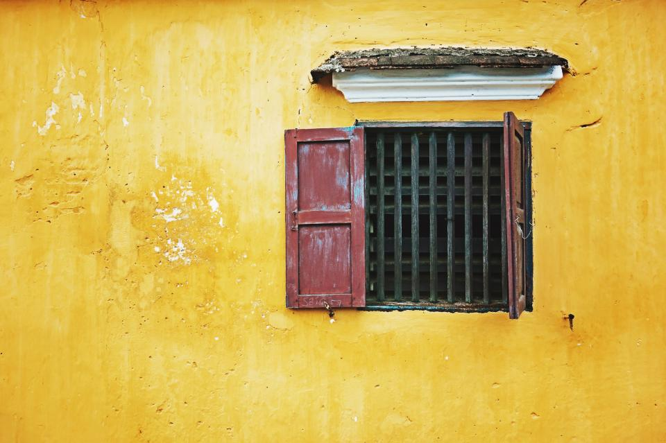 house yellow wall window frame outside