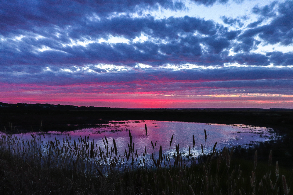 pink sunset clouds water nature outdoors landscape sky climate weather environment