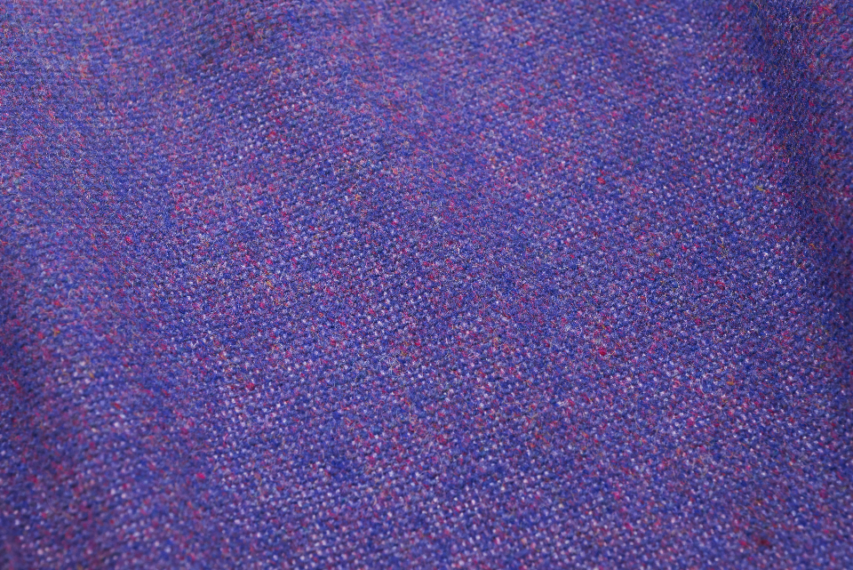 purple fabric texture tweed cloth weave closeup threads woven textile background material clothing sewing macro crafts copy space
