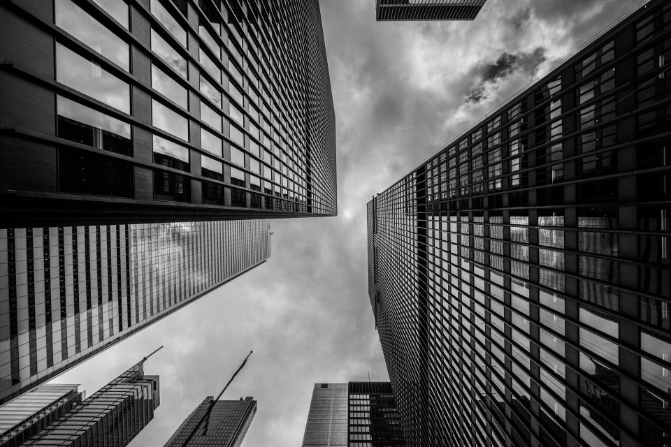 buildings towers high rises architecture city dark storm clouds cloudy black and white