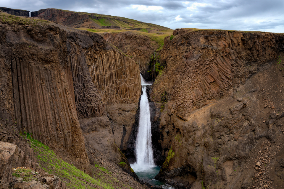 mountain waterfall iceland rural countryside water nature outdoors landscape scenic hiking tourism travel explore adventure rugged rocky terrain sky clouds