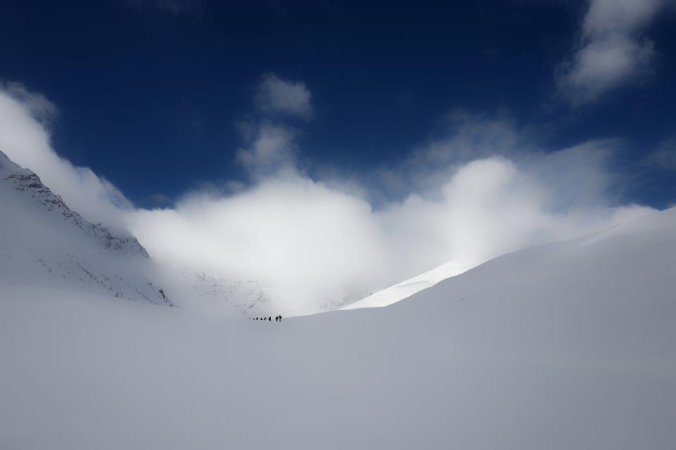 mountain snow winter clouds sky people men skier skiing mountaineering sport