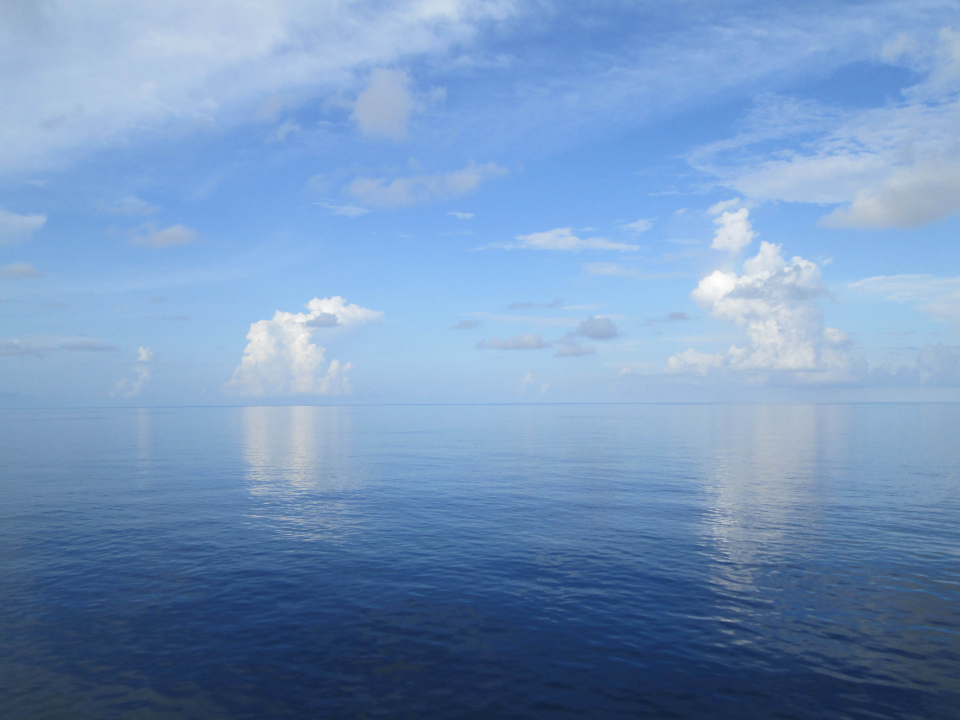 ocean sky clouds horizon sea nature seascape puffy scenic view travel cloudscape reflection climate day