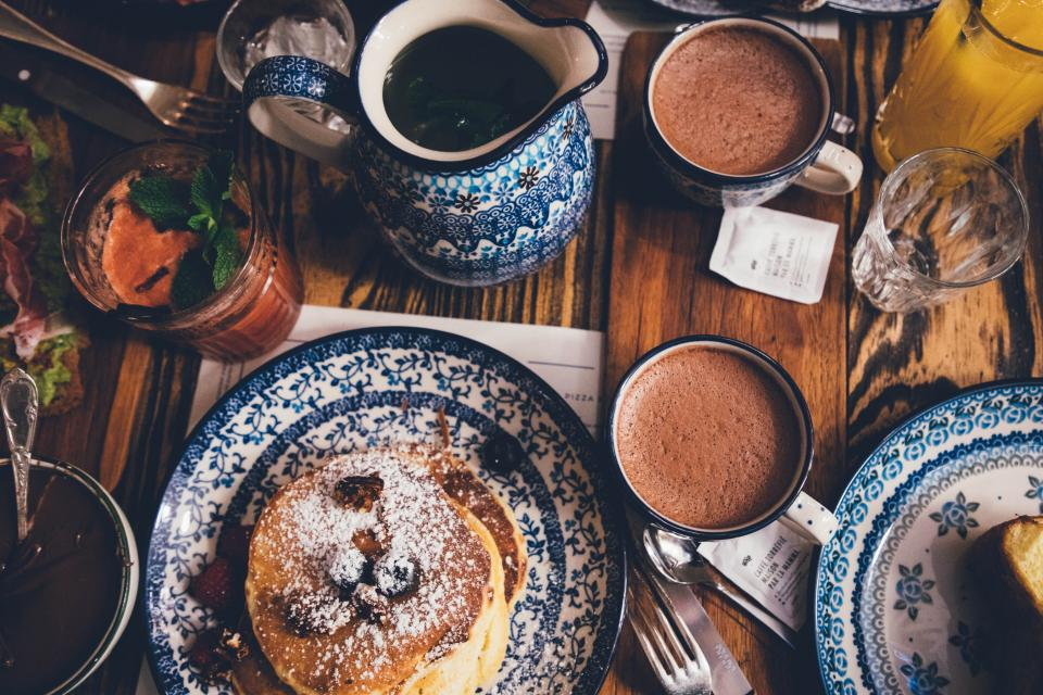 hot chocolate drink food cup glass tea juice plate pancake snack table restaurant