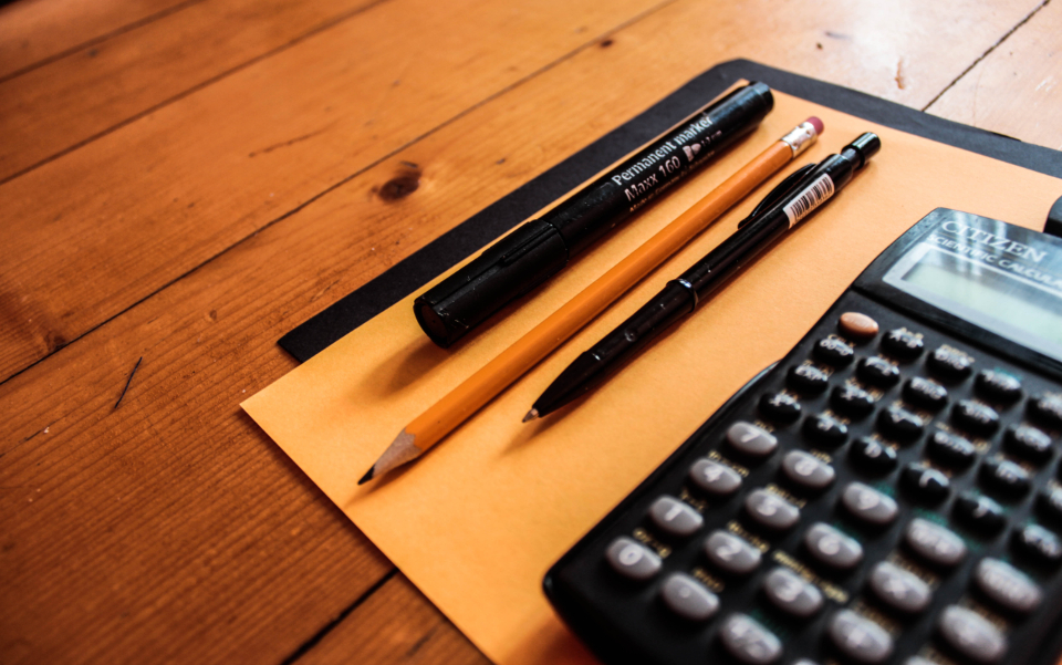 calculator pencil pen paper table office work business training calculations