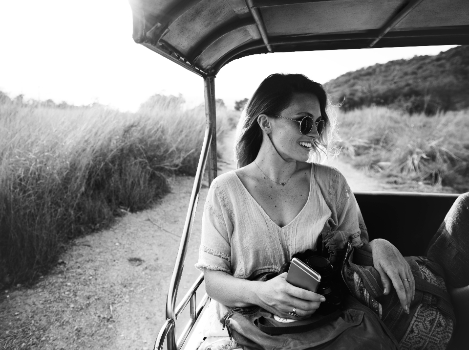 car ride person phone joy vehicle holidays valley road carefree travel transportation caucasian wanderlust adventure girl nature woman happy casual trip eyeglasses smiling grass camera journey leisure tourism scenic