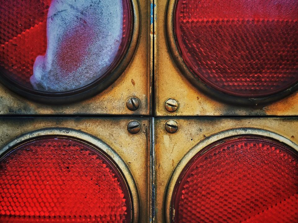 close up macro details red circle screw round stop light