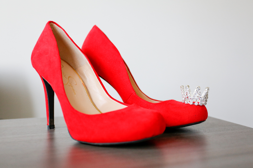 red heels shoes table crown fashion footwear female glamour woman design object stiletto classic