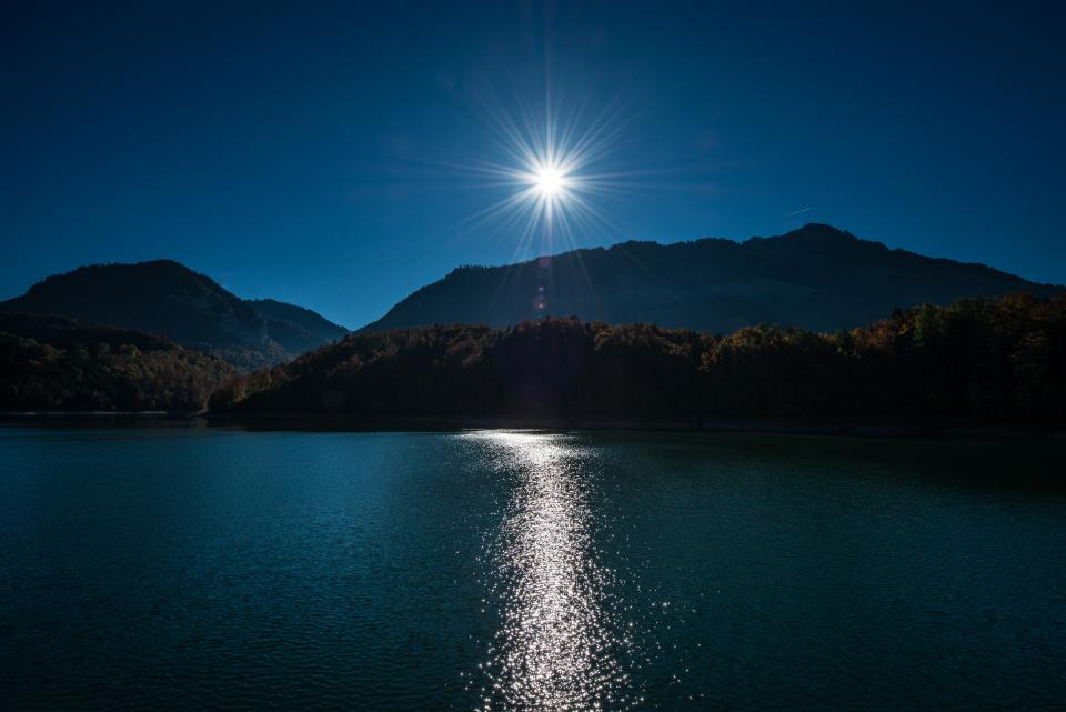 night sky moon light mountain highland landscape lake sea water reflection trees plant nature