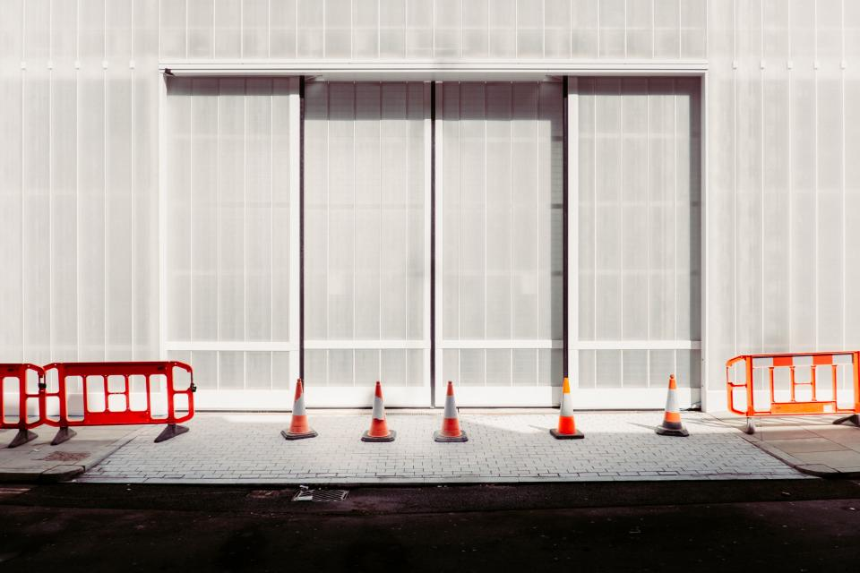 wall window covering building street traffic cone orange