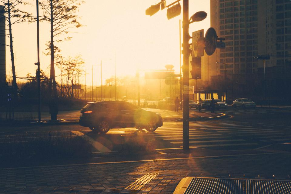 street road intersection sunset city urban suv traffic lights