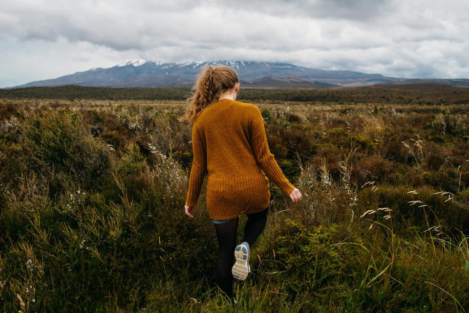people girl walking hiking adventure travel outdoor green grass mountain landscape highland nature
