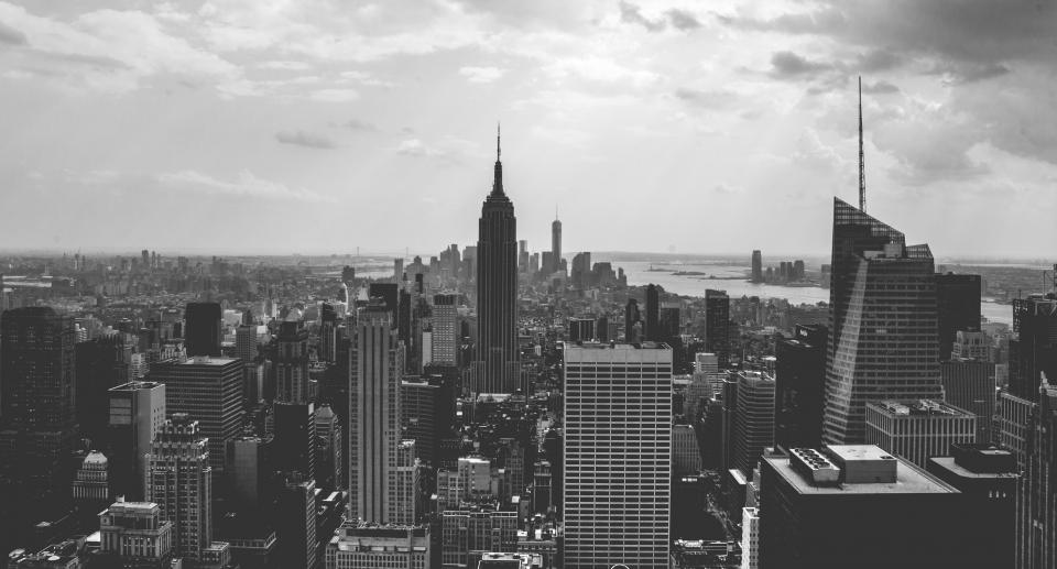 New York NYC city urban downtown architecture buildings skyscrapers high rises towers skyline cityscape sky clouds rooftops black and white