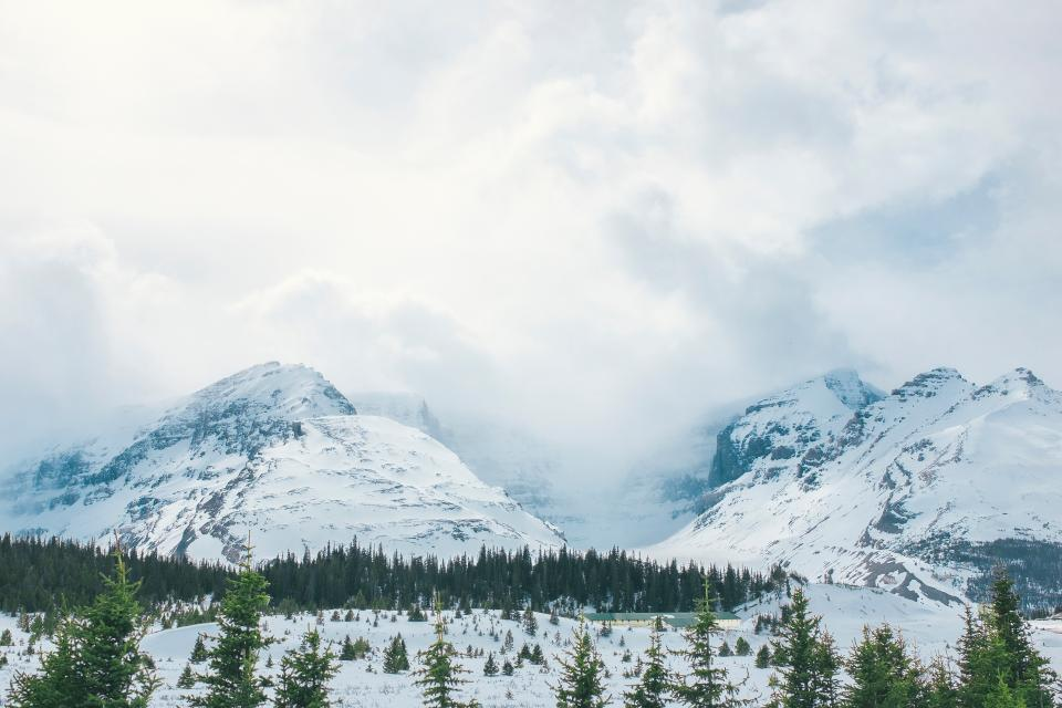 mountain highland cloud sky summit ridge landscape nature valley hill snow winter view travel trees plant