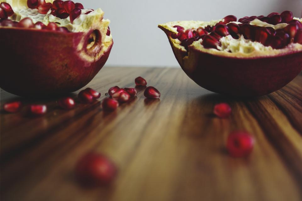 wooden table pomegrate fruit food vitamins blur
