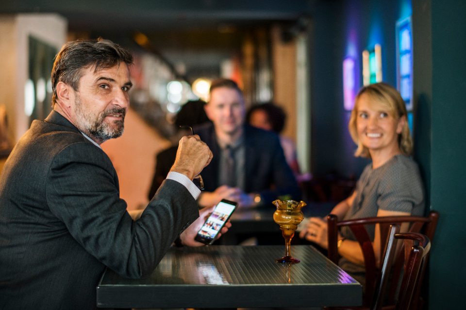 after work bar bearded blond blond hair boss business business people businessman businesswoman caucasian ceo colleagues corporate coworkers feed friday hanging out manager mature meeting messaging on social online out of office partners people p