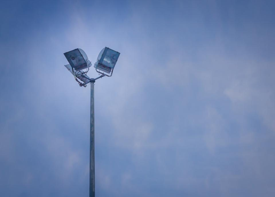 blue sky clouds lights lamp post spot lights