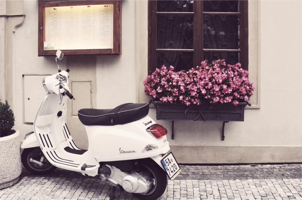 vespa scooter moped cobblestone flowers pot
