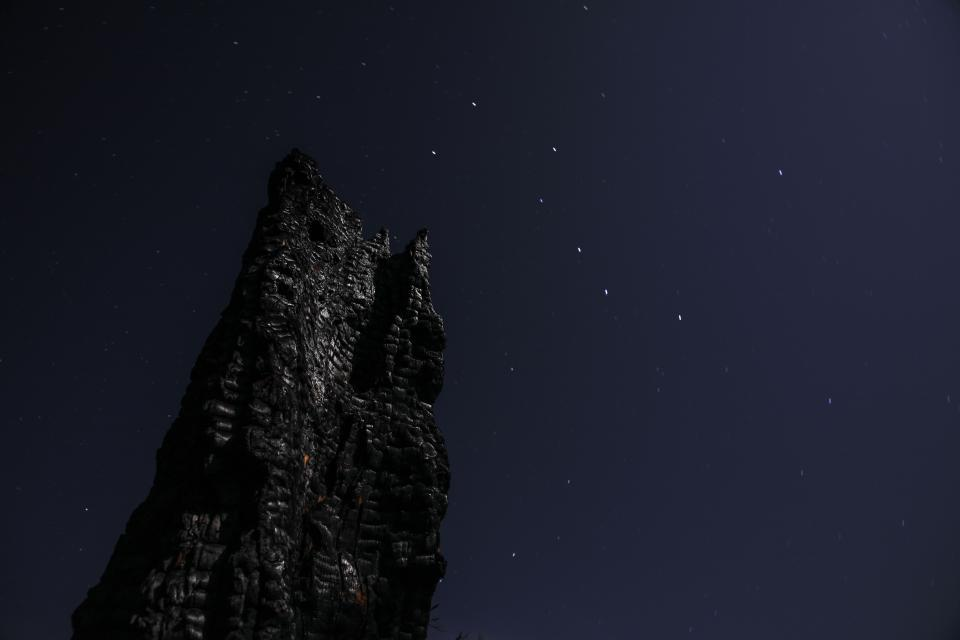 dark night stars sky rocks cliff nature landscape
