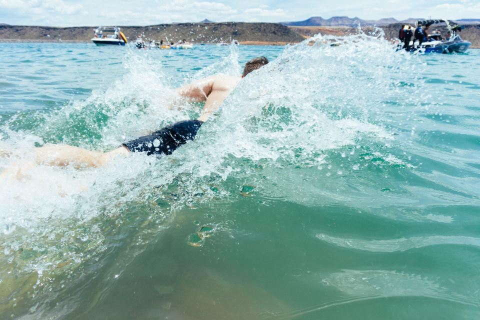 sea ocean water waves people man swimming sport boat nature mountain