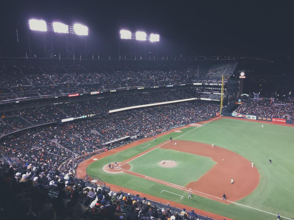 baseball stadium field diamond crowd people spectators sports athletes night dark spotlights fun entertainment team