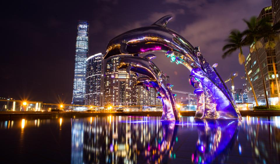 architecture buildings infrastructures night sky skyscraper tower city urban skyline cityscape hotesl dolphins sculpture art landmark water reflections neon