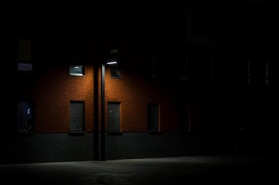 dark night alley street lamp post architecture building apartment establishment