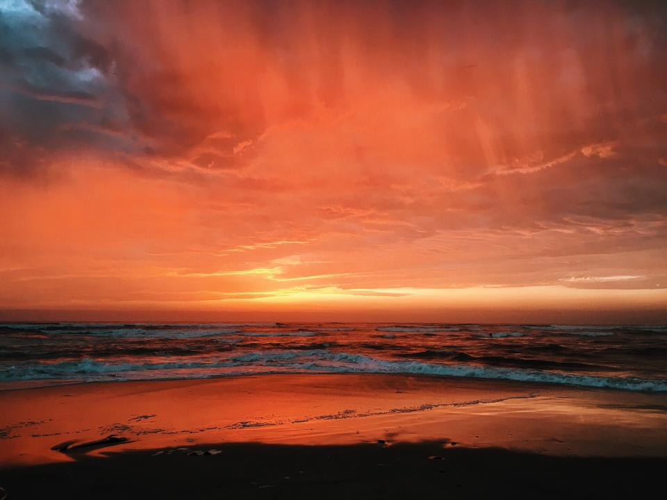 red sky clouds beach coast sea ocean water nature sunset