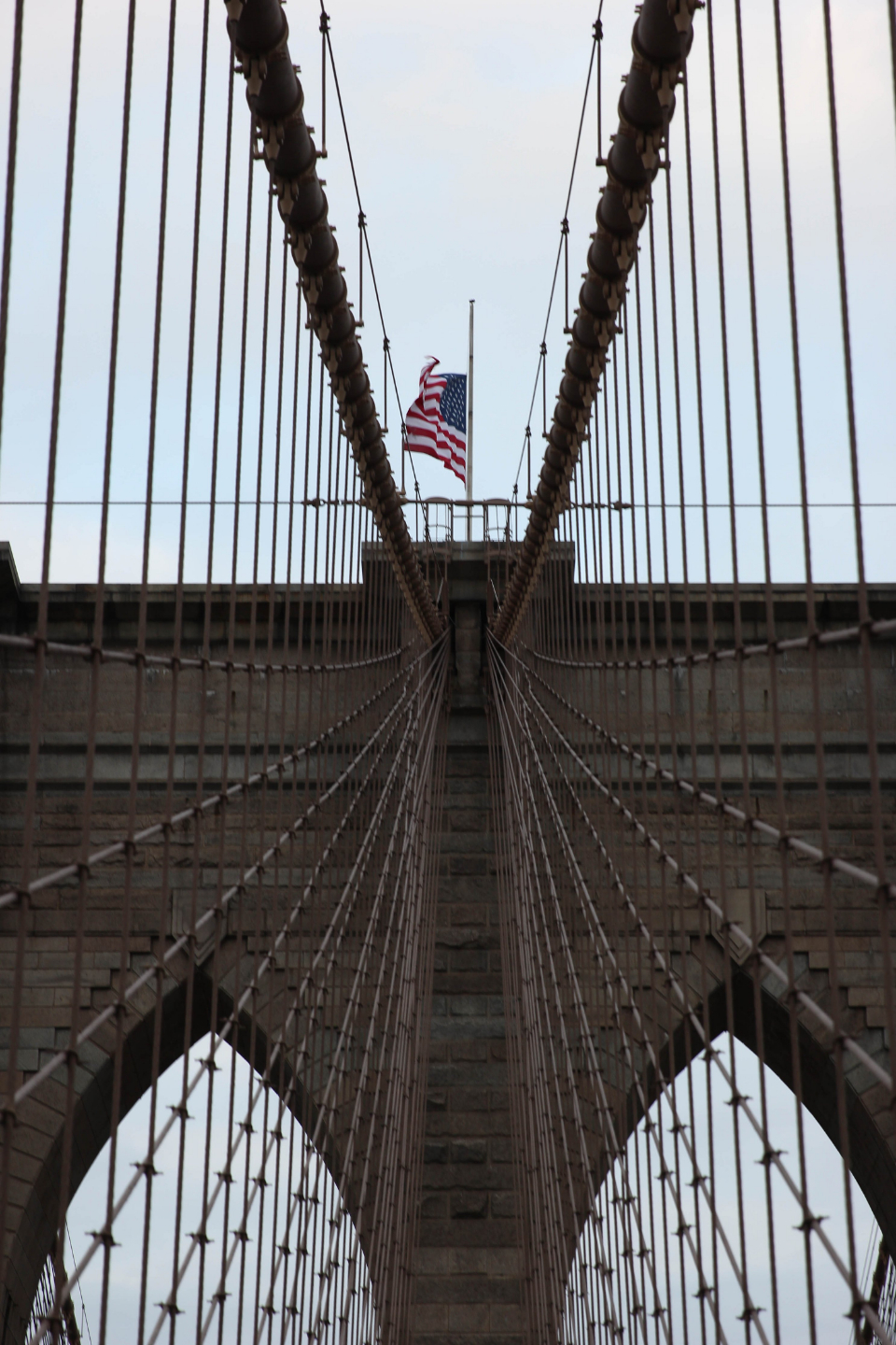 american flag bridge cables architecture structure sky brooklyn new york construction steel downtown landmark tourism suspension travel