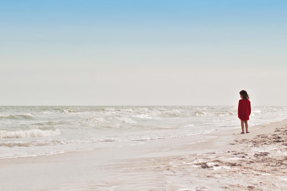 sea ocean water waves nature horizon blue sky clouds summer coast shore beach sand people girl standing alone kid child