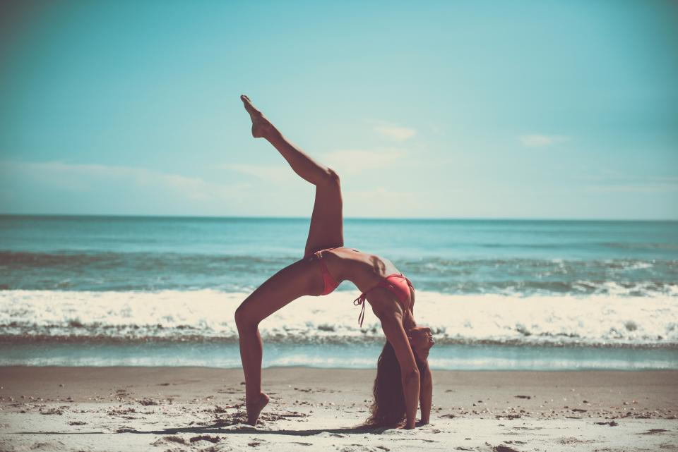 yoga pose stretch health fitness working out bikini beach sand sunshine summer ocean sea waves water shore girl woman people beauty