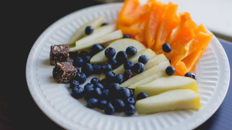 fruit plate food blueberries pear snack healthy assorted fresh diet organic colorful close up
