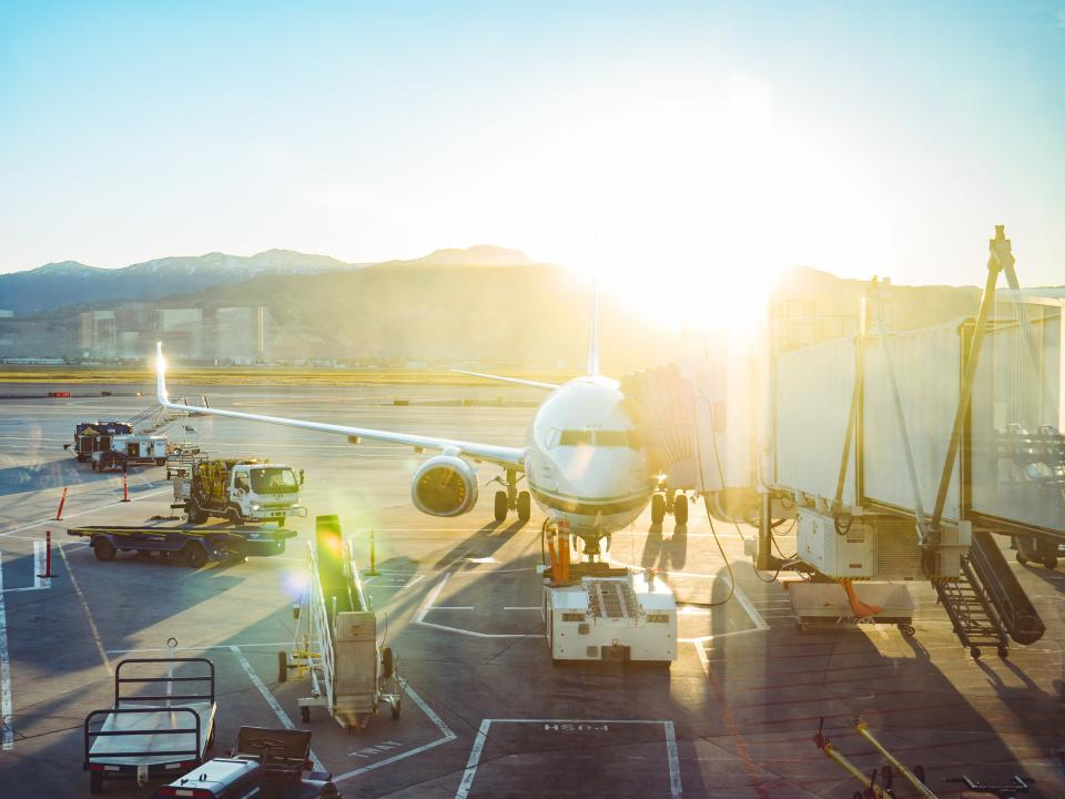 airport airplane transportation runway airline truck vehicle cargo travel morning trip sunshine sunlight sunrise