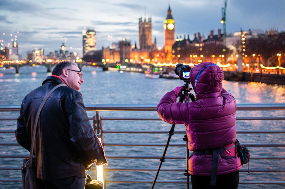 people man woman photography camera photo picture urban city dark lights architecture tower building establishment bridge water ocean sea river lake old clouds sky