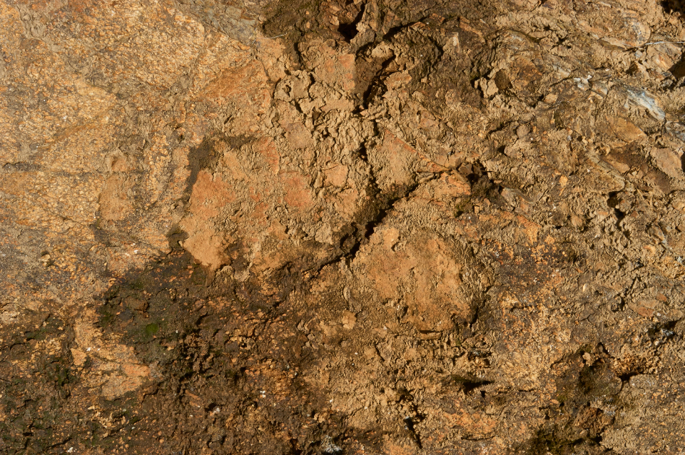dirt rock texture muddy wet sandy dirty nature background outdoors ground earth soil brown tan weathered