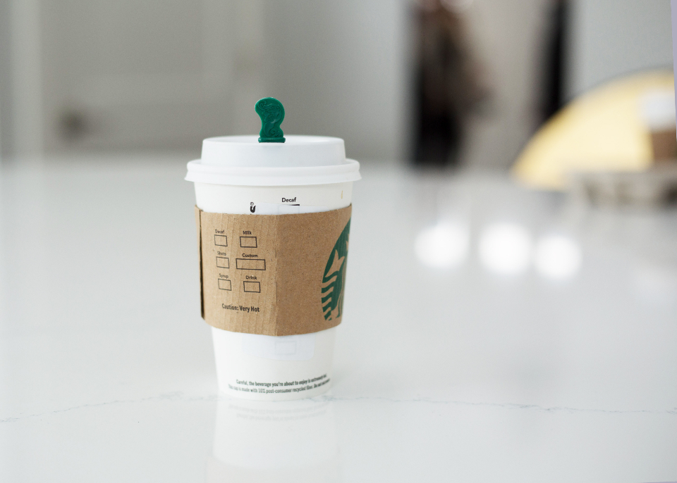 coffee cup drink latte hot beverage cafe restaurant breakfast caffeine paper table counter