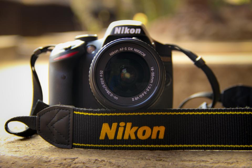 camera dslr nikon lens black photography strap blur
