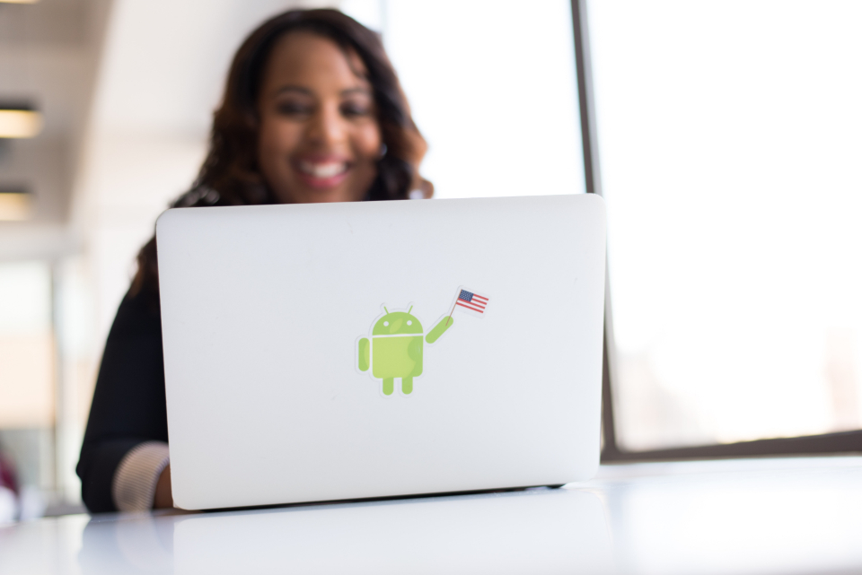 woman android laptop developer coder smile happy american flag desk office female people